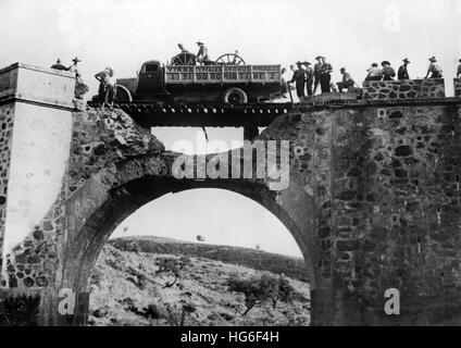 The Nazi propaganda picture shows the reconstruction of a destroyed bridge by Francos troops during the Spanish - Stock Photo