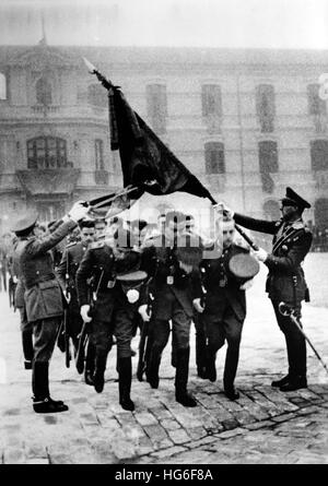 The Nazi propaganda picture shows the solemn handover of a flag to the Military Academy in Saragossa, Spain, December - Stock Photo