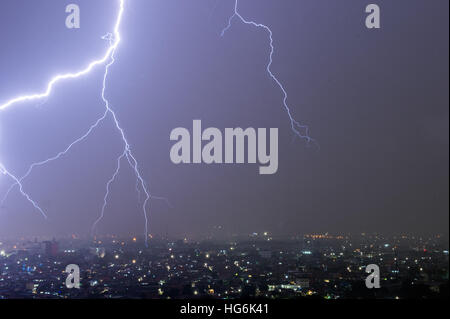 Jakarta, Indonesia. 6th Jan, 2017. A lightning hits the city of Jakarta, capital of Indonesia, Jan. 6, 2017. © Du - Stock Photo