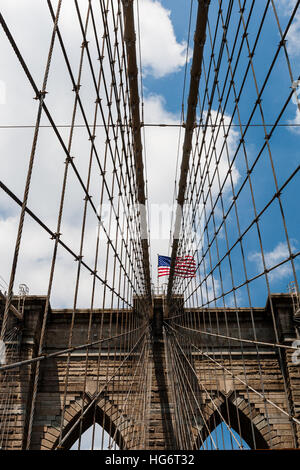 The Brooklyn Bridge is a bridge in New York City and is one of the oldest suspension bridges in the United States. - Stock Photo