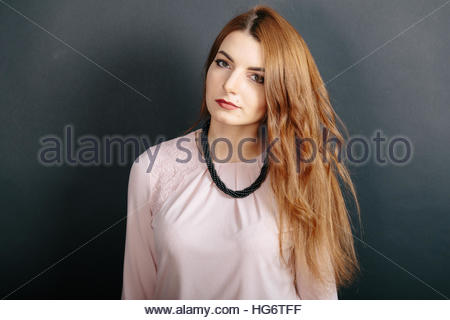 a young attractive redhaired redhead ginger haired woman girl model