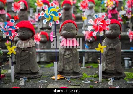 Jizo statues of unborn children at Shiba park in Tokyo - Stock Photo