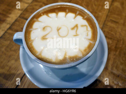 Year 2017 drawn in froth of cup of coffee, London - Stock Photo