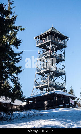 view tower on Velka Cantoryje hill in Slezske Beskydy mountains on czech-polish borders during winter day with clear - Stock Photo