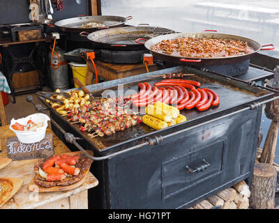 Typical Hungarian colorful street food including sausages, Shaslik, Goulash, and Kukorica (Mais). - Stock Photo
