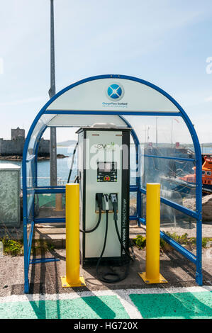 Evolt electric vehicle charging point at Castlebay on the island of Barra in the Outer Hebrides. - Stock Photo
