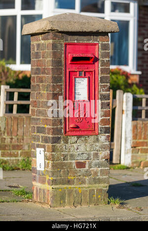 Red Royal Mail wall mounted letter box. Postbox. Mailbox. - Stock Photo