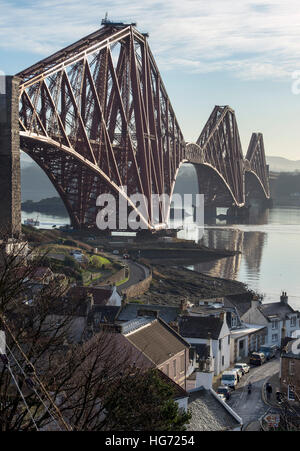 The Forth Rail Bridge viewed from the village of North Queensferry looking south over the Firth of Forth. - Stock Photo