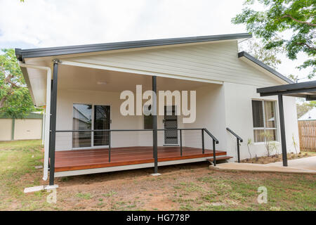 New contemporary style home with timber deck in front - Stock Photo