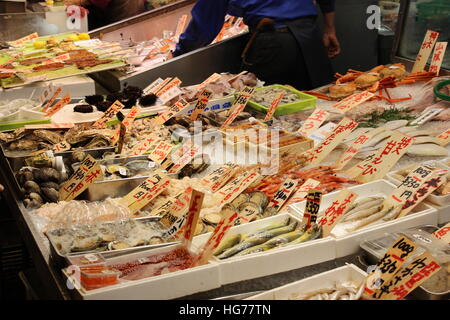 Fresh seafood for sale at Tsukiji Market in Tokyo, Japan - Stock Photo