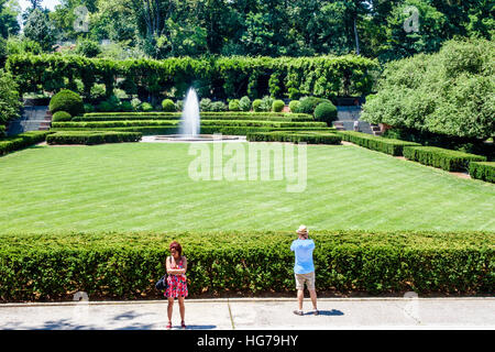 Manhattan New York City NYC NY Spanish Harlem Central Park urban Conservatory Garden formal garden fountain man - Stock Photo