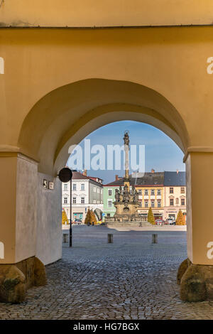 Passage from Assumption Church, Plague Column at namesti Masaryka in Moravska Trebova, Moravia, Czech Republic - Stock Photo