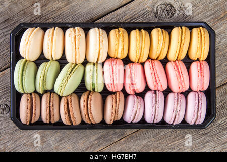 French delicious dessert macaroons in box.Top view. - Stock Photo