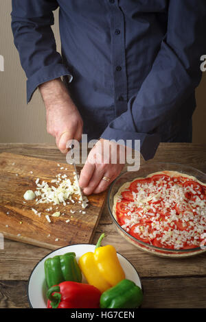 Sliced onion pizza on a cutting board vertical - Stock Photo