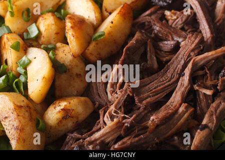 Tasty Pulled pork with baked potatoes macro. horizontal background - Stock Photo