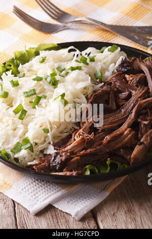 Pulled pork with coleslaw close-up on a plate on the table. vertical - Stock Photo