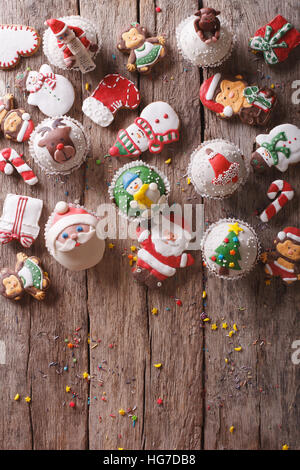 Background of Christmas sweets on a wooden table. vertical top view - Stock Photo