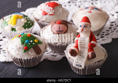 Fabulous Christmas cupcakes decorated  close-up on the table. horizontal - Stock Photo