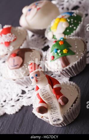 Beautiful delicious Christmas cupcakes closeup. vertical - Stock Photo