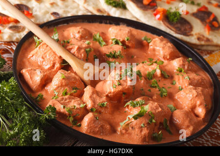Indian tikka masala chicken close-up on the table. horizontal - Stock Photo