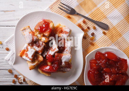 Delicious omelette Kaiserschmarrn with plum sauce close-up on a plate. horizontal top view - Stock Photo