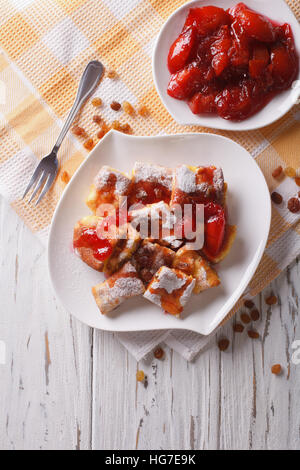 Delicious omelette Kaiserschmarrn with plum sauce on a plate. vertical top view - Stock Photo