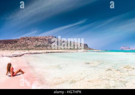A beautiful woman on Balos beach in Crete island, Greece. - Stock Photo