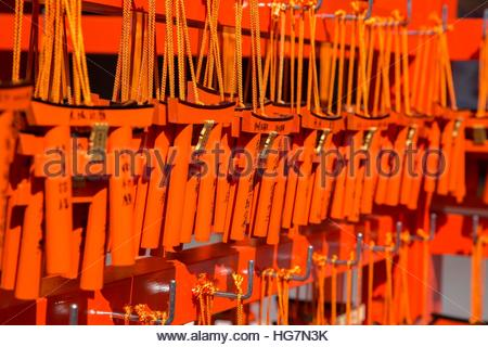Votive plaques, or ema, for good fortune, for sale at Fushimi-Inari Taisha. - Stock Photo