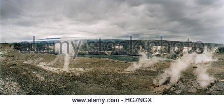 Steam escaping from vents near the rim of Halemaumau Crater in Kilauea Caldera. - Stock Photo