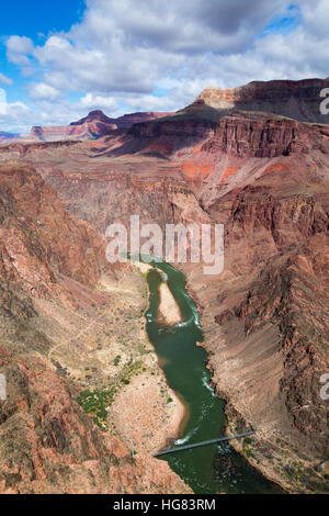 The Colorado River flowing through the Grand Canyon below the Silver Suspension Bridge. Grand Canyon National Park, - Stock Photo