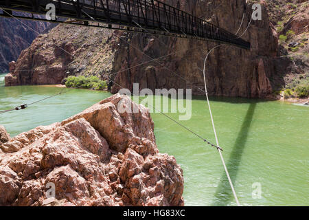 The Black Suspension Bridge along the Kaibab Trail system at the bottom of the Grand Canyon. Grand Canyon National - Stock Photo