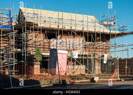 New houses being built in the UK. House building site. - Stock Photo