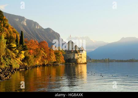 Chillon Water Castle at Lake Geneva, Veytaux with mountain chain Dents du Midi, Vaud, Switzerland - Stock Photo