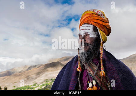 Portrait of Sadhu, holy man, looking into the himalayan mountains, Muktinath, Mustang District, Nepal - Stock Photo