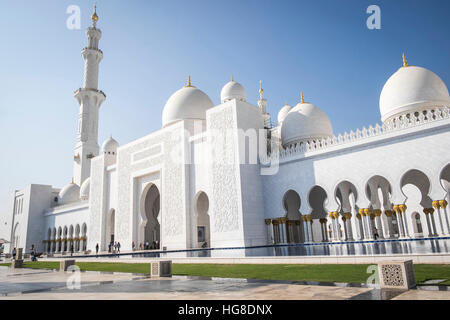 Low angle view of Sheikh Zayed Mosque against clear blue sky on sunny day - Stock Photo