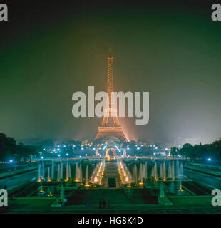 Eiffel Tower at night in Paris, France - Stock Photo