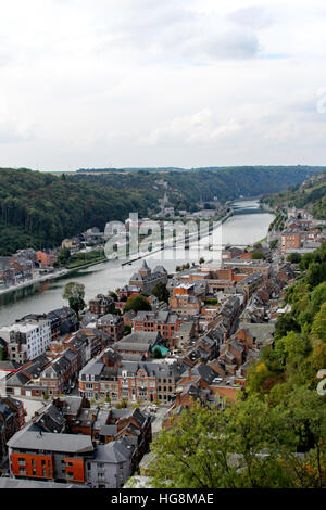 The city of Dinant in Belgium hugs both sides of the Meuse River. - Stock Photo