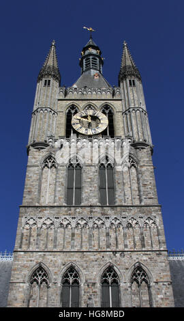 Clock tower in the Cloth Hall Ypres, Ieper, a reconstruction of the original building destroyed in World War I - Stock Photo