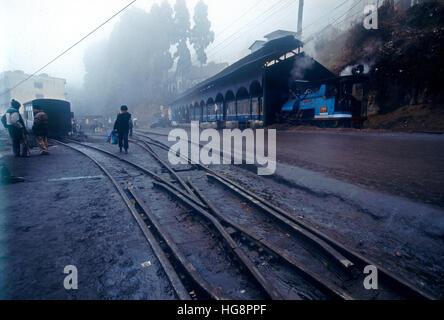narrow gauge tracks leading to Shimla railway station in the early morning fog - Stock Photo