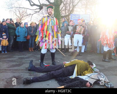 Members of Handsworth Sword Dancers perform a Robin Hood Mummer's Play on Boxing Day outside St Mary's, Handsworth, - Stock Photo