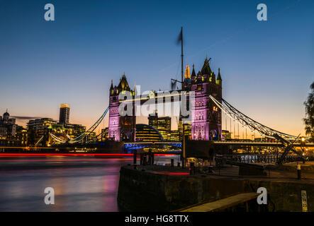 Orange and dark blue skies of the late sunset behind Tower Bridge, London, UK Stock Photo
