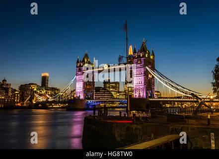 Orange and dark blue skies of the late sunset behind Tower Bridge, London, UK - Stock Photo