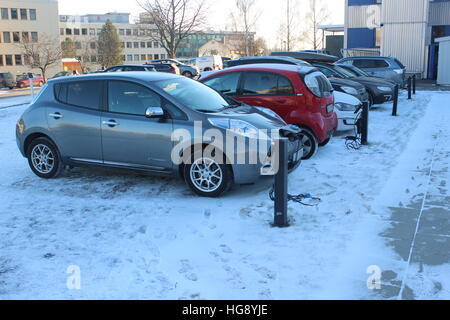 Electric cars charging in the cold weather in Norway - Stock Photo