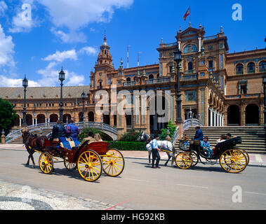 Tourists in Horse drawn carriage at the Plaza de Espana, Seville, Andalucia,Andalusia, Spain - Stock Photo