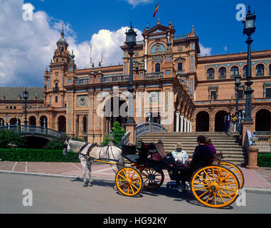 Tourists in Horse drawn carriage at the Plaza de Espana, Seville, Andalucia, Spain - Stock Photo