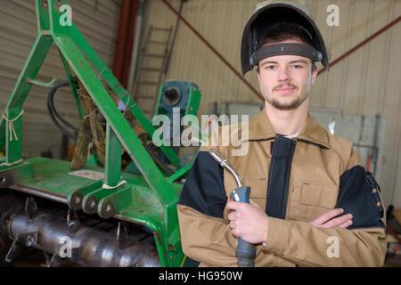 Female Apprentice Welder Welding In Car Factory Stock Photo ...