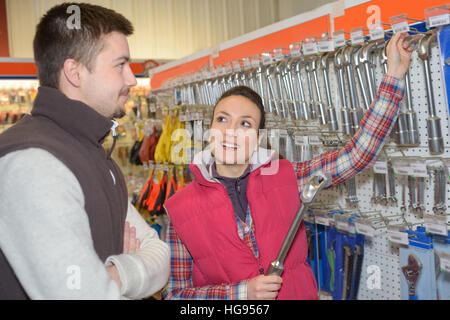 beautiful hardwarestore saleswoman helping customer - Stock Photo