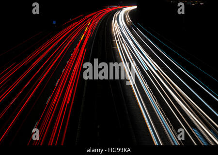 Car light trails on the M40 motorway at night. Oxfordshire, England - Stock Photo