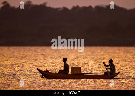 Traditional fisherman boating in Arugam bay lagoon, Sri Lanka - Stock Photo