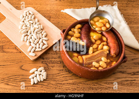 Fabada Asturiana (Asturian bean stew with bacon, sausage and blood sausage) - Stock Photo